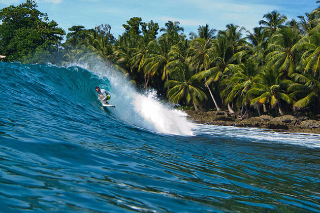 Surfing in the Mentawai Islands - thing to do for incredible Sumatra tours