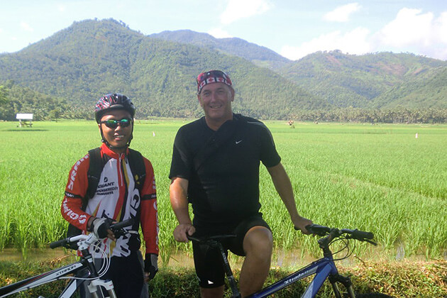 cycling through rice paddies - interesting activities in lombok tour